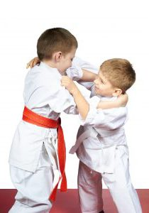 Two young athletes train judo sparring